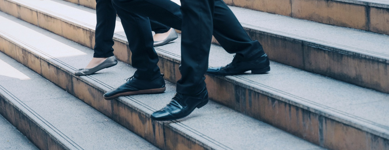 men walking down concrete staircase in dress slacks and dress shoes, lds