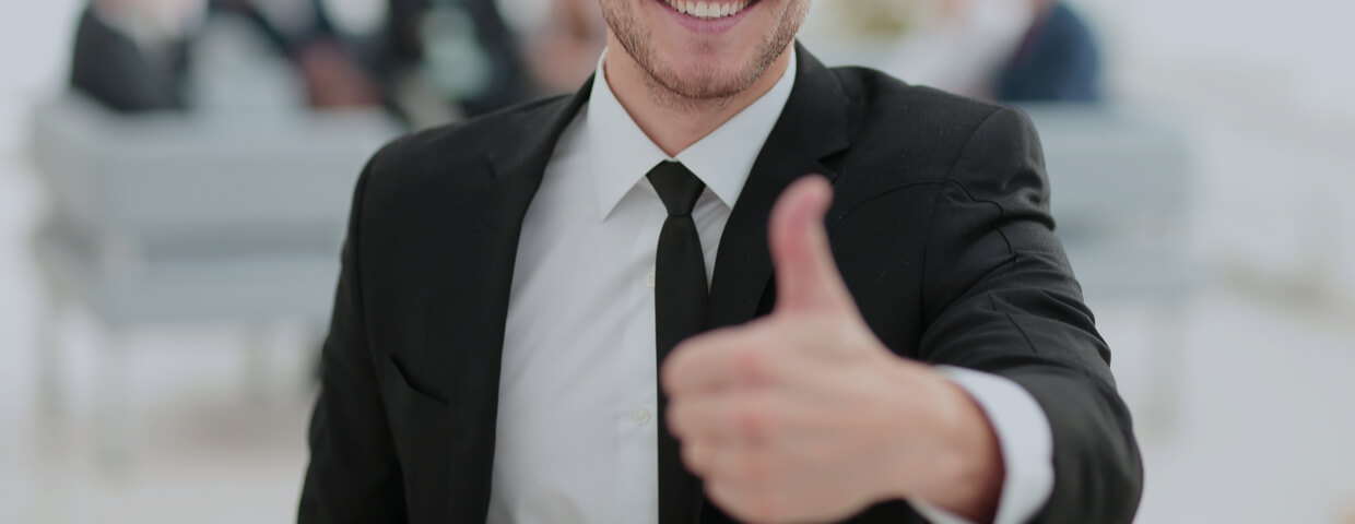 young adult male, wearing suit, very happy, giving thumbs up gesture